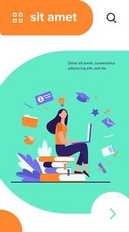 オンラインコースで勉強しているラップトップを持つ学生。本のスタックに座って、コンピューターを使用している女性