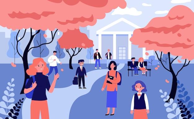 학교 운동장에있는 학생들. 빨간 나무와 학교 건물 그림 사이에서 걷는 어린이와 청소년. 가을, 배너, 웹 사이트 또는 방문 웹 페이지에 대한 학교 개념으로 돌아 가기