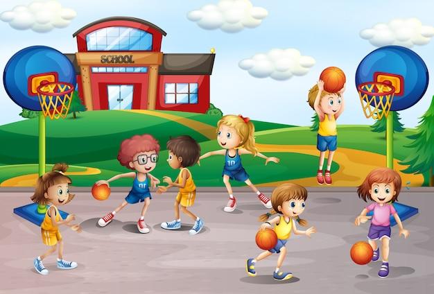 체육에서 농구하는 학생들
