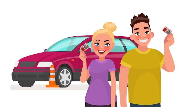 운전 면허증과 훈련 차를 소지 한 학생