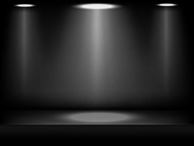 暗い背景に抽象的なスタイルで黒のスタジオの背景。スポットライトのビームで照らされた抽象的なスタジオの黒い背景。製品デモンストレーションのステージ暗い部屋のインテリア。