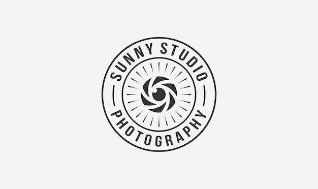 Studio photographer stamp logo design with the sun and lens element.