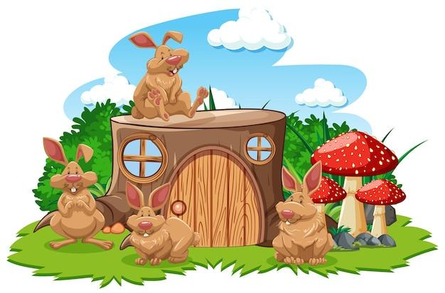 白い背景の上の3つのマウスの漫画スタイルの切り株の家
