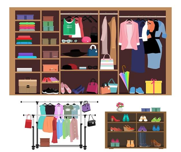 Стильный шкаф с модной одеждой, обувью и сумками.