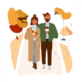 Stylish couple walking in autumn park