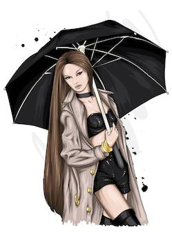 아름 다운 코트와 우산에 세련 된 소녀.