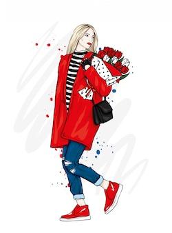 コートとジーンズでスタイリッシュな女の子。花の花束を持つ美しい少女。