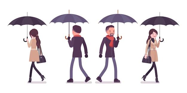 秋の服のイラストで歩く傘を持つスタイリッシュな男性と女性