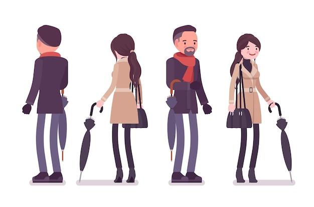 秋の服のイラストを身に着けている傘を持つスタイリッシュな男性と女性