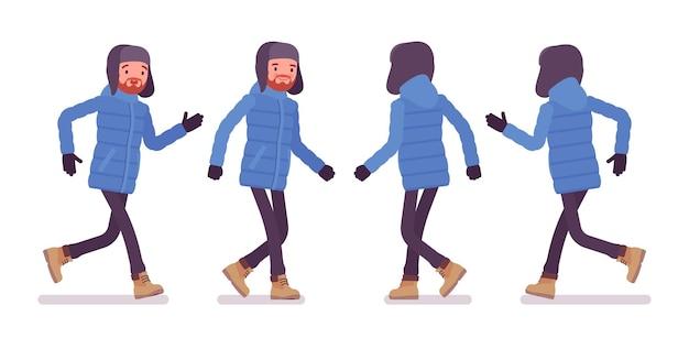 Stylish man in a blue down jacket walking
