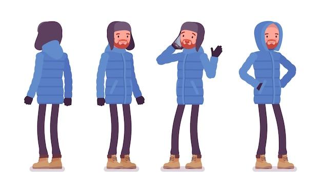 立っている青いダウンジャケットのスタイリッシュな男