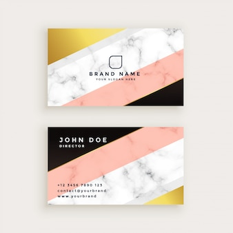 Stylish marble business card with geometric gold and pastel colors