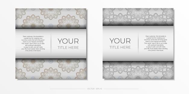 豪華なヴィンテージの装飾が施された白い色のスタイリッシュなポストカードデザイン。ギリシャのパターンとベクトルの招待状。