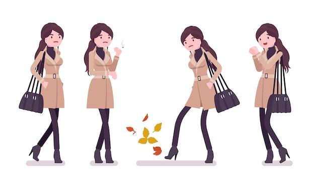 秋の服のイラストを着て寒さを感じるスタイリッシュな女性
