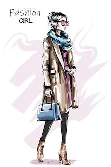 코트에 세련 된 여자입니다.