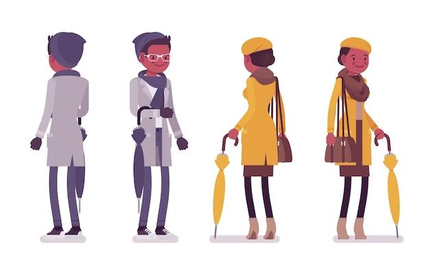 秋の服のイラストを身に着けている傘を持つスタイリッシュな若い黒人男性と女性