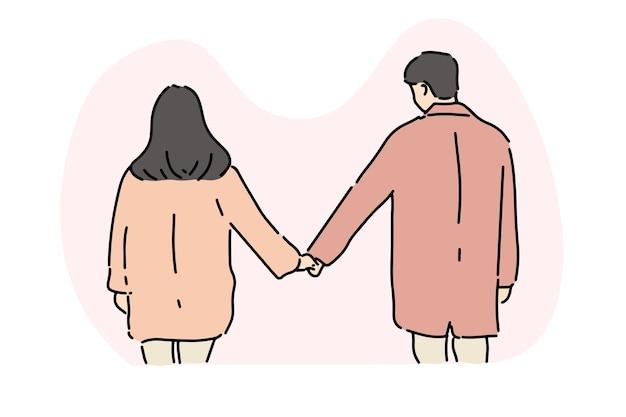 손을 잡고 세련 된 젊은 부부,