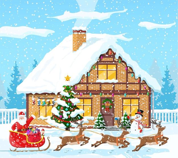 Загородный дом засыпан снегом. здание в праздничном орнаменте. рождественский пейзаж елка, снеговик, олени санях санта. новогоднее украшение. с рождеством христовым праздник рождества. иллюстрация