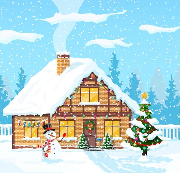Загородный дом засыпан снегом. здание в праздничном орнаменте. елка новогоднего пейзажа, снеговик. с новым годом украшение. с рождеством христовым. новогоднее празднование рождества. иллюстрация