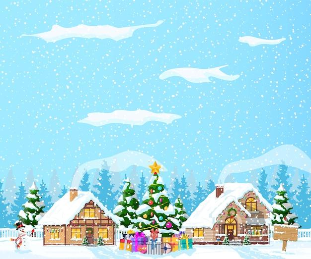 Загородные дома засыпаны снегом. здание в праздничном орнаменте. рождественский пейзаж елка ель, снеговик. с новым годом украшение. с рождеством христовым. новогоднее празднование рождества.