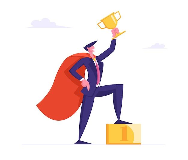 スーパーヒーローケープで成功したビジネスマンは、ゴールデンポディウムにゴールドゴブレットスタンドを保持します