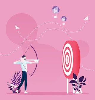Successful businessman aiming target with bow and key arrow
