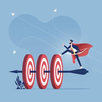 成功したビジネスマンは弓と矢で多くのターゲットをヒット