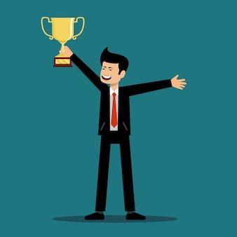 성공적인 남자는 승자의 컵을 보유