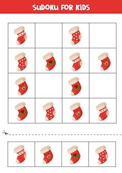 크리스마스 양말을 신은 아이들을위한 스도쿠. 아이들을위한 교육 논리 게임.
