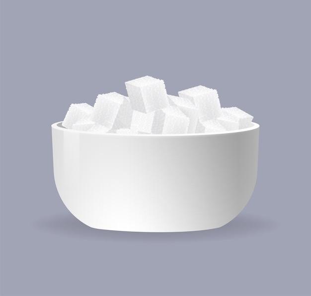 Sugar cubes on bowl