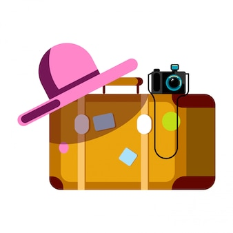 Suitcase with pink hat and photo camera isolated on white