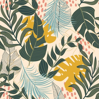 Summer abstract seamless pattern with colorful tropical leaves and plants on beige