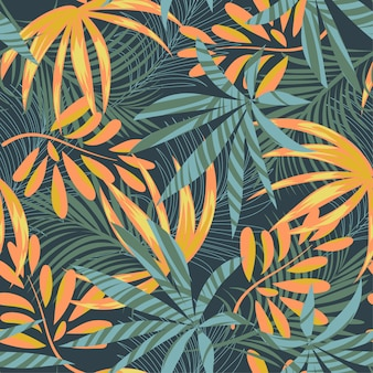 Summer abstract seamless pattern with colorful tropical leaves and plants on blue