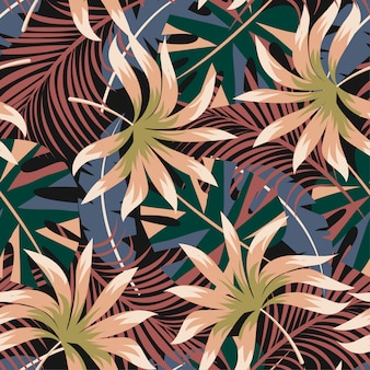 Summer abstract seamless pattern with colorful tropical leaves and plants on a dark background