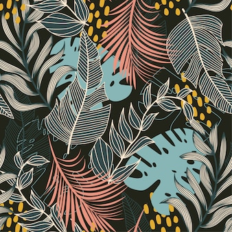 Summer abstract seamless pattern with colorful tropical leaves and plants on a dark