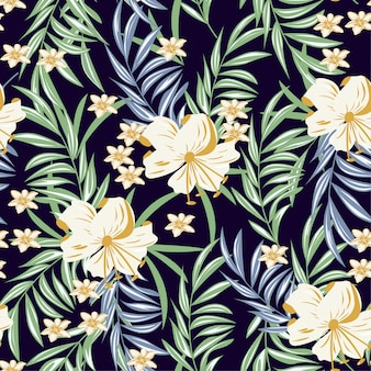 Summer abstract seamless pattern with colorful tropical leaves and plants on purple background