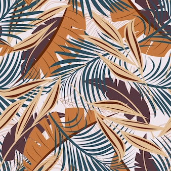 Summer abstract seamless pattern with colorful tropical leaves and plants