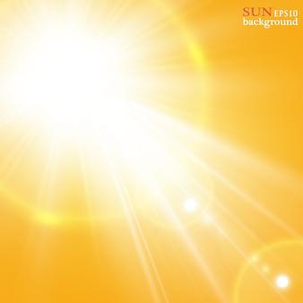 壮大な夏の太陽と夏の背景は、レンズフレアでバーストしました。あなたのテキストのためのスペース。