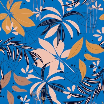 Summer bright seamless pattern with colorful tropical leaves and plants on blue background