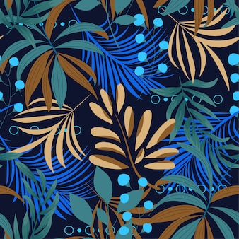 Summer bright seamless pattern with colorful tropical leaves and plants on a dark background