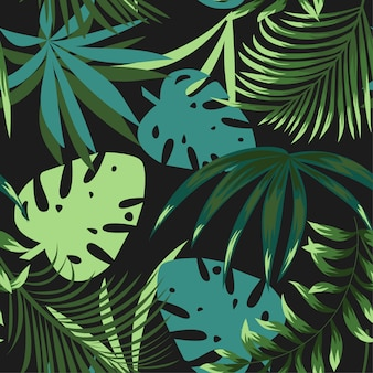 Summer bright seamless pattern with colorful tropical leaves and plants on green background