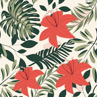 Summer bright seamless pattern with colorful tropical leaves and plants on pastel background