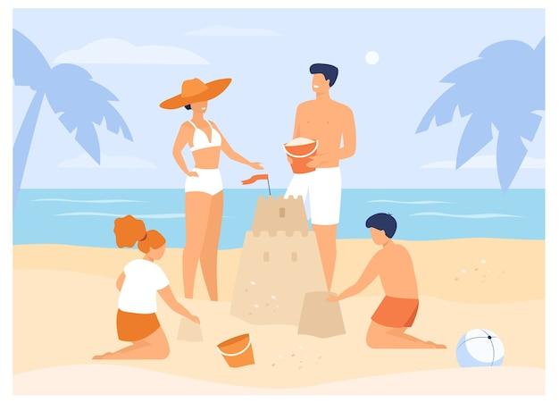 Летние семейные мероприятия. дети, мама и папа строят замок из песка на пляже. для тропического курорта, отдыха, туризма