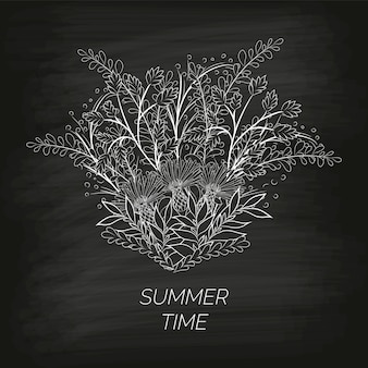 Summer floral background in the form of a wreath of cornflowers and leaves drawn by hand on the black unclean chalkboard.