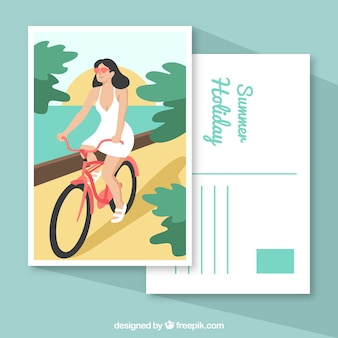 Summer holiday postcard with girl riding a bicycle