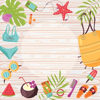 Summer items frame wooden background