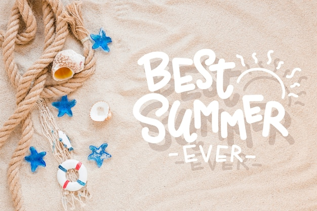 Summer lettering with beach sand and sea shells