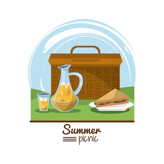 Summer picnic with picnic basket and sandwich and juice jar