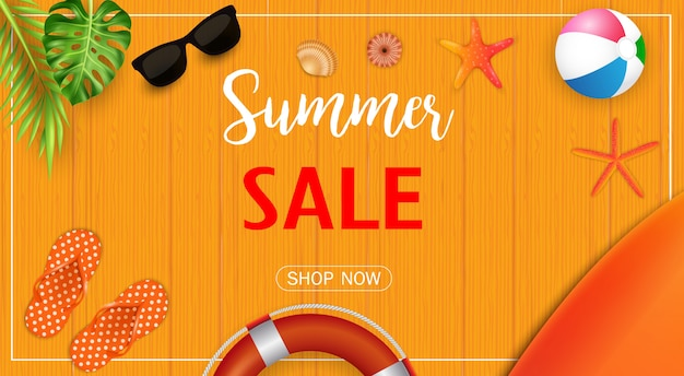 Summer sale banner with beach elements on wooden texture