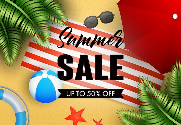 Summer sale lettering with beach mat, ball and umbrella